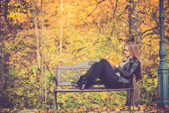 Pretty girl in fall reading Stock Photo