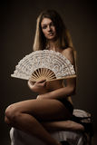 Pretty girl with fan Royalty Free Stock Photography