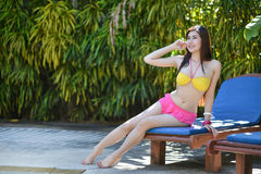 Pretty girl in fancy bikni around pool side Royalty Free Stock Images