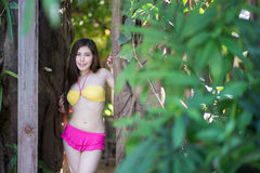 Pretty girl in fancy bikni around pool side Royalty Free Stock Photography