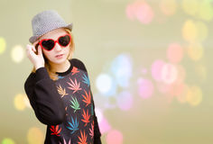 Pretty girl in fancy sunglasses on colorful bokeh Stock Photos