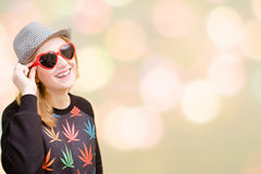 Pretty girl in fancy sunglasses on colorful bokeh Stock Images