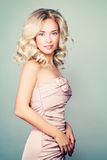 Pretty Girl Fashion Model with Blonde Curly Hairstyle Stock Photography