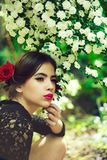 Pretty girl with fashionable spanish makeup, rose flower in hair. Pretty girl with fashionable makeup and red lips, has rose flower in hair hispanic or spanish stock photos
