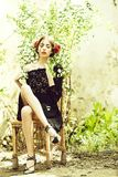 Pretty girl with fashionable spanish makeup, rose flower in hair. Woman in garden. pretty girl with fashionable makeup and red lips, has rose flower in hair royalty free stock images