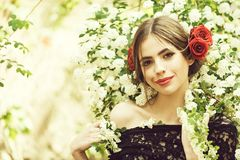 Pretty girl with fashionable spanish makeup, rose flower in hair. Woman. pretty girl with fashionable makeup and red lips, has rose flower in hair hispanic or stock image