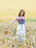 Pretty girl in a field Royalty Free Stock Photos