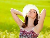 Pretty girl in a field Stock Photo