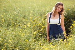 Pretty girl in field Stock Photos