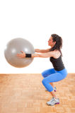 Pretty girl with fitness ball Stock Photos