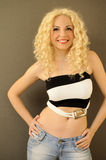 Pretty girl with flat belly stock images