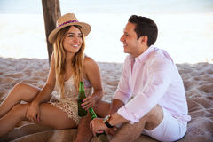 Pretty girl flirting with her date at the beach Royalty Free Stock Image