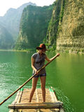 Pretty girl floating on a bamboo raft Royalty Free Stock Photos