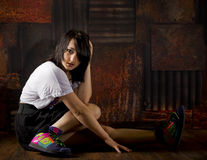 Pretty girl on floor with grunge background Royalty Free Stock Image