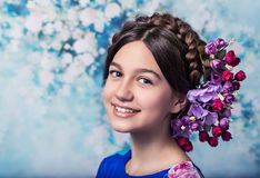Pretty girl with floral decoration, smiling Royalty Free Stock Image