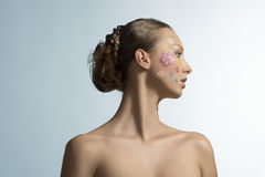 Pretty girl with floral make-up, turned in profile Stock Image