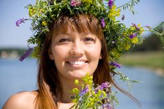 Pretty girl with floral wreath Royalty Free Stock Images