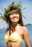 Pretty girl in floral wreath Royalty Free Stock Image
