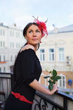 Pretty girl with flower on balcony outdoor Stock Photos