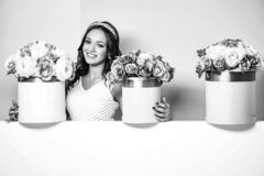 Pretty girl with flower boxes royalty free stock photo