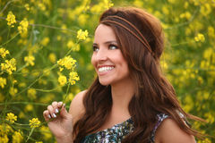 Pretty Girl in a Flower Field Royalty Free Stock Image