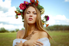 Pretty girl in flower wreath with naked shoulders Stock Photography