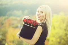 Pretty girl with flowers in box royalty free stock image