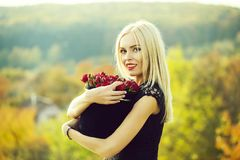 Pretty girl with flowers in box stock photography