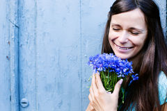 Pretty girl with flowers Royalty Free Stock Images