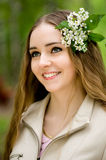 Pretty girl with flowers in her hair Stock Photos
