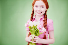 Pretty girl with flowers Royalty Free Stock Photography