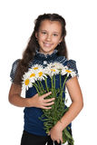 Pretty girl with flowers Stock Photos