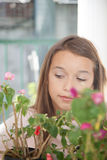 Pretty girl with flowers. Pretty girl smelling some flowers Stock Images