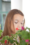 Pretty girl with flowers Stock Image