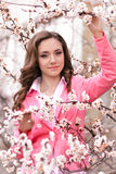 Very beautiful girl in blossoming trees in spring garden. Spring. stock photo