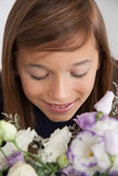 Pretty girl with flowers Royalty Free Stock Photos