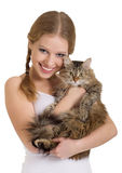 Pretty girl with a fluffy cat. On a white background royalty free stock photos