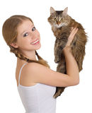 Pretty girl with a fluffy cat. On a white background royalty free stock photo