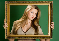 Pretty girl with frame Stock Photos