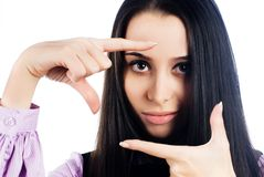 Pretty girl with frame gesture. Focus on fingers Stock Photography