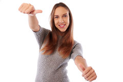 Pretty girl with frame gesture of thumbs up posing at the camera Stock Image