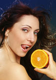 Pretty girl with fresh orange Stock Image