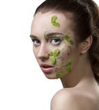 Pretty girl with fresh summer make-up. Close-up portrait of pretty girl with nacked shoulders, creative fresh summer make-up with mint leaves Stock Images