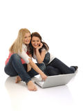 Pretty girl friends surfing in internet Royalty Free Stock Photo