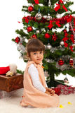 Pretty girl in front of Christmas tree Stock Photo
