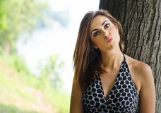 Pretty girl with funny expression, outdoors Stock Image