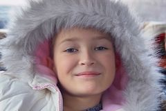 Pretty girl with fur. Beautiful girl in fur parka Royalty Free Stock Photography