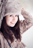 Pretty girl with fur cap Stock Image