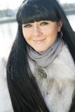 Pretty girl in fur coat Stock Image