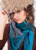 Pretty girl in a fur hat Royalty Free Stock Photos